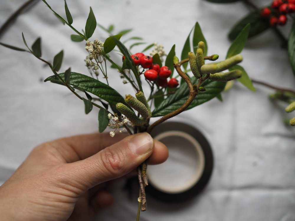 Form a small posy with the first few elements of the wreath