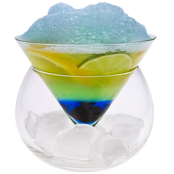 Blue lagoon cocktail with edible alcoholic foam