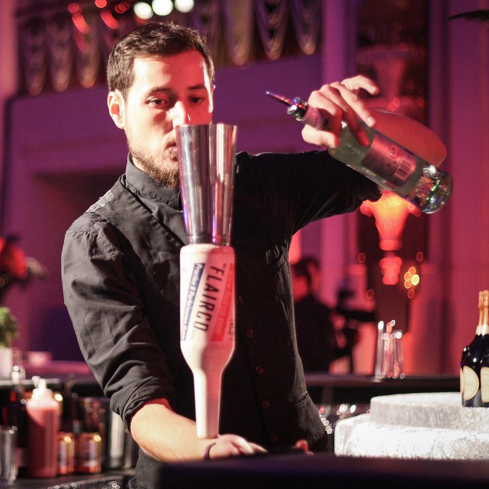 Flair Barman   Our elegant  Flair Bartender  are highly trained and is perfect for any special event. Be it a Wedding, Hen, Cocktail or Private Party, Corporate event and Bat Mitzvah. They are able to entertain you by the 'juggling' of bar tools, Bottles and equipment, adding some Magic to your event and adding value to the guest experience.    Book Now