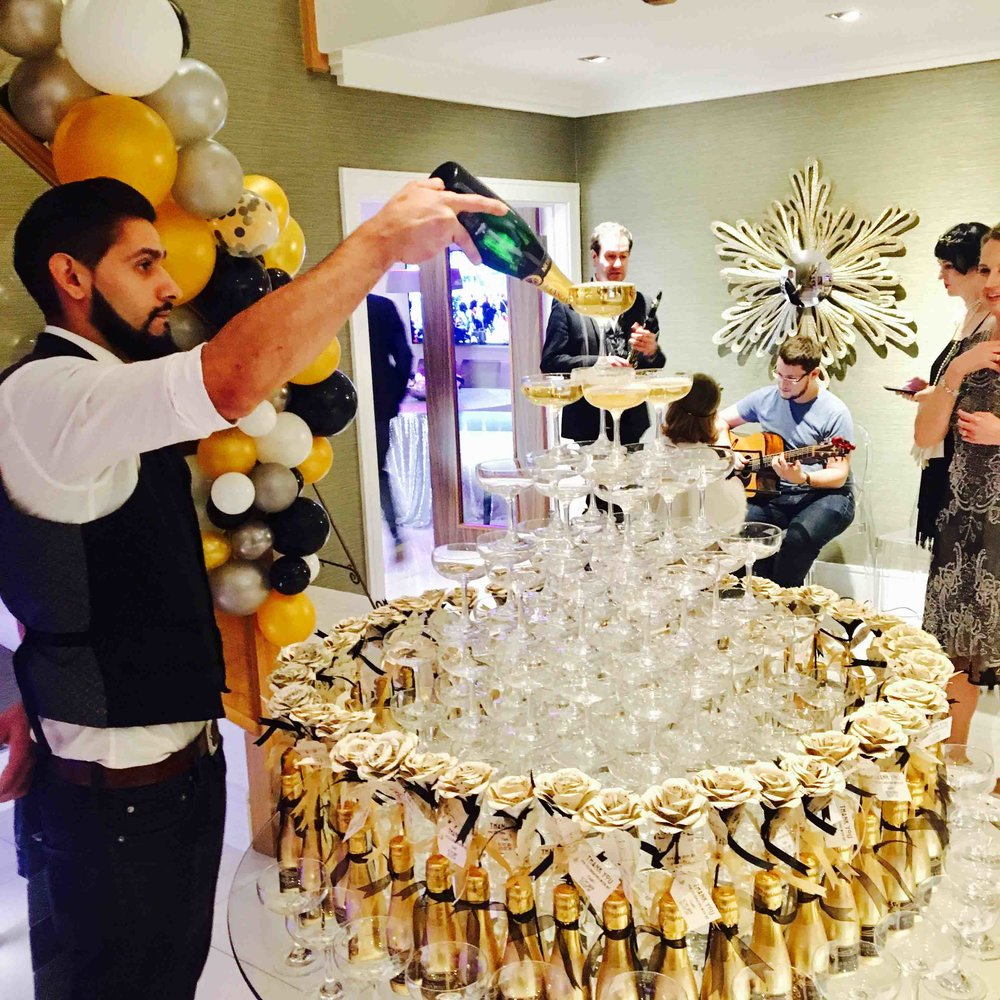 bartender with champagne tower