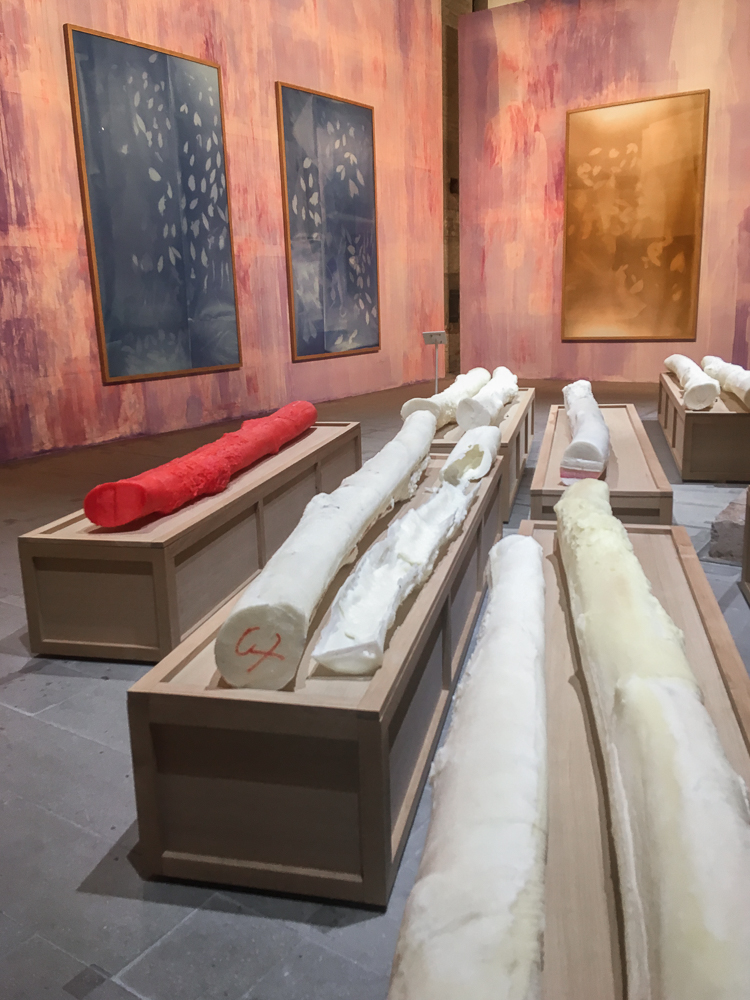 """- Others standouts were Thu Van Tran's rubber tree casts, photograms and painted walls; portions of Kader Attia's """"Narrative Vibrations""""; Edith Dekyndt's """"One Thousand and One Nights"""", a carpet of dust lit by a spotlight; and Alicja Kwade's perceptually confounding and materially impressive """"WeltenLinie"""", a work comprised of stone, mirror, bronze, aluminum, petrified wood, steel, and rusted iron that perfectly occupies the tail end of the exhibition in the Arsenale's interior space."""