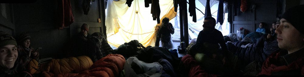 It was sleeting outside so everybody rushed from far and wide to the shelter on the top of Tray Mountain. We tied up rain flies to protect from the wind and rain and bundled up in our sleeping bags from mid day until 4pm when we were so hungry we started making dinner.