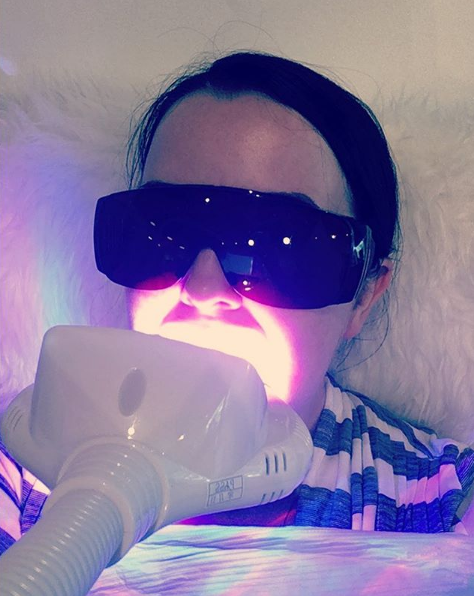 Our esthetician, Sarah, enjoying an in-studio SunnaSmile treatment