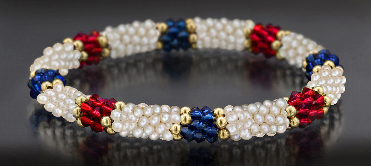 white bracelet with red and blue accents