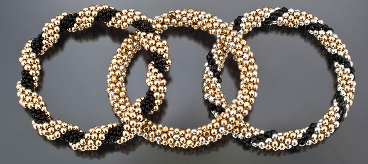 3 bracelets black and gold colors
