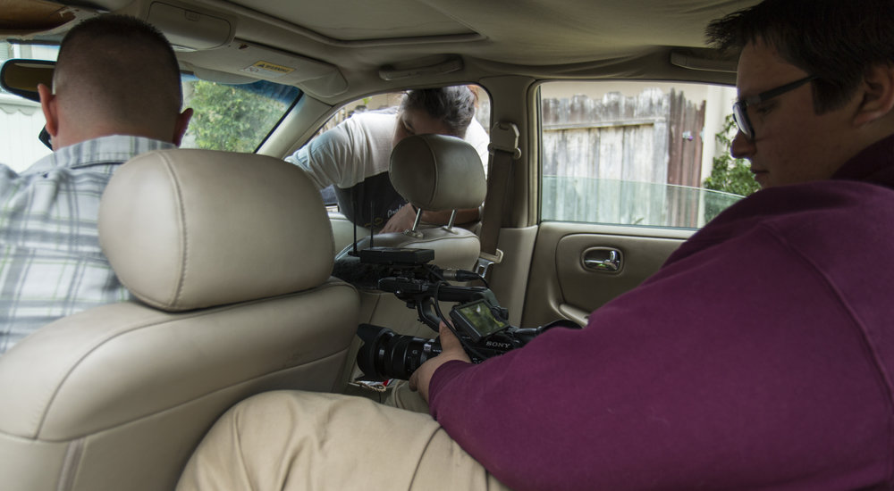 Austin filming from back seat.JPG