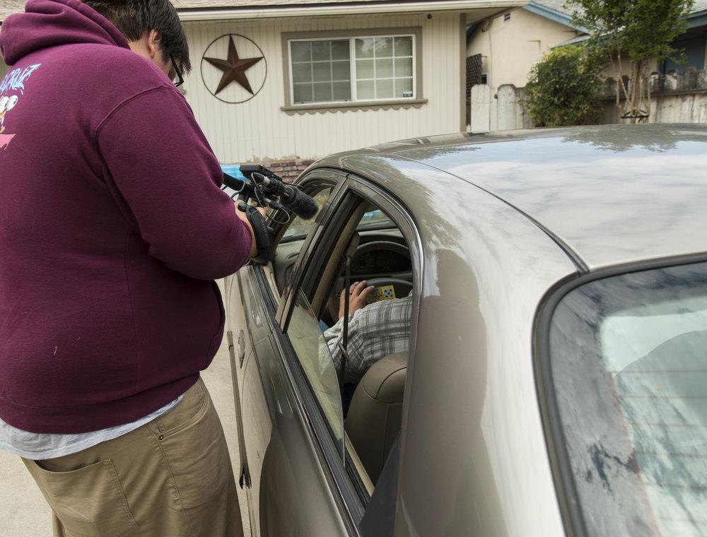 Austin filming into car.JPG