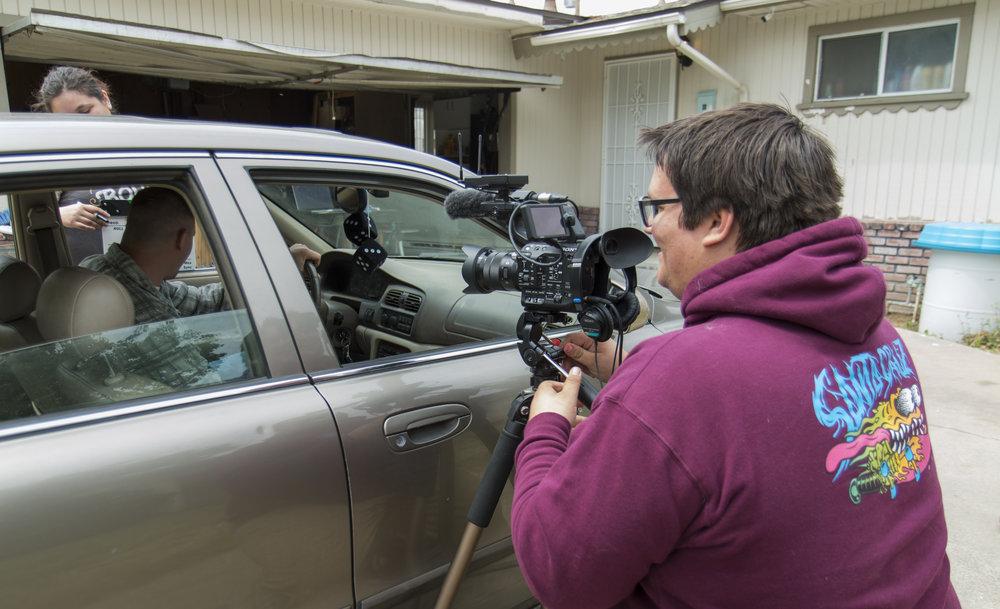 Austin filming on fs5 outside car.JPG
