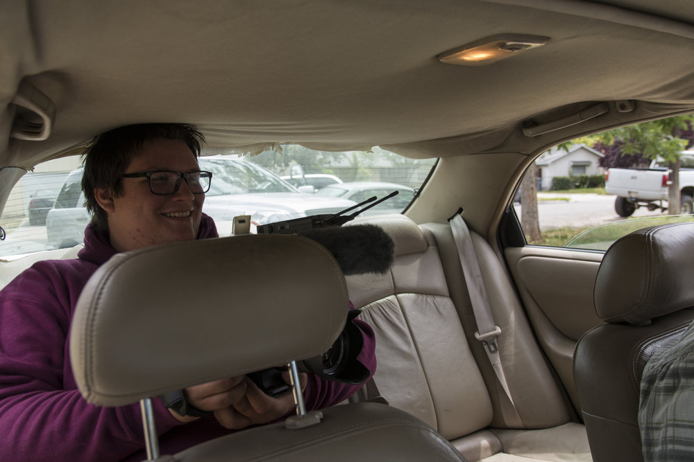 Austin smiling in back seat with fs5.JPG