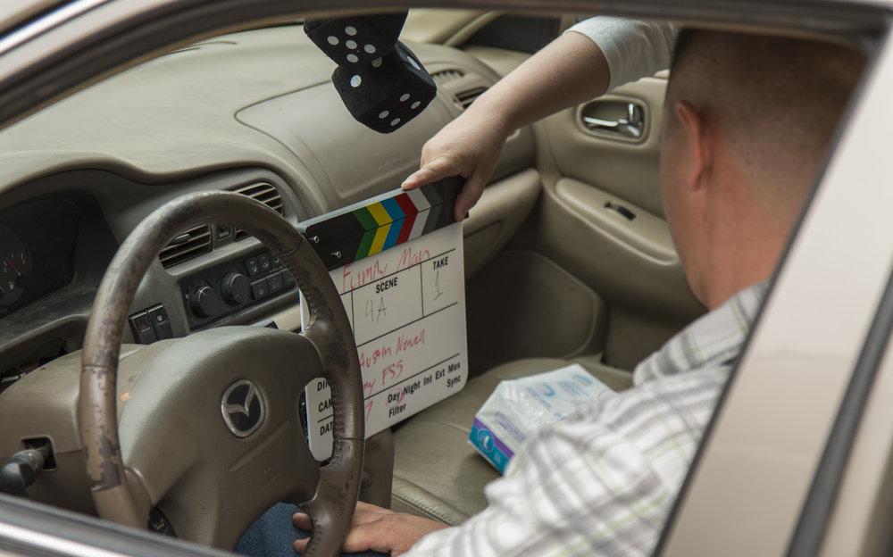 Clapboard in action in car.JPG
