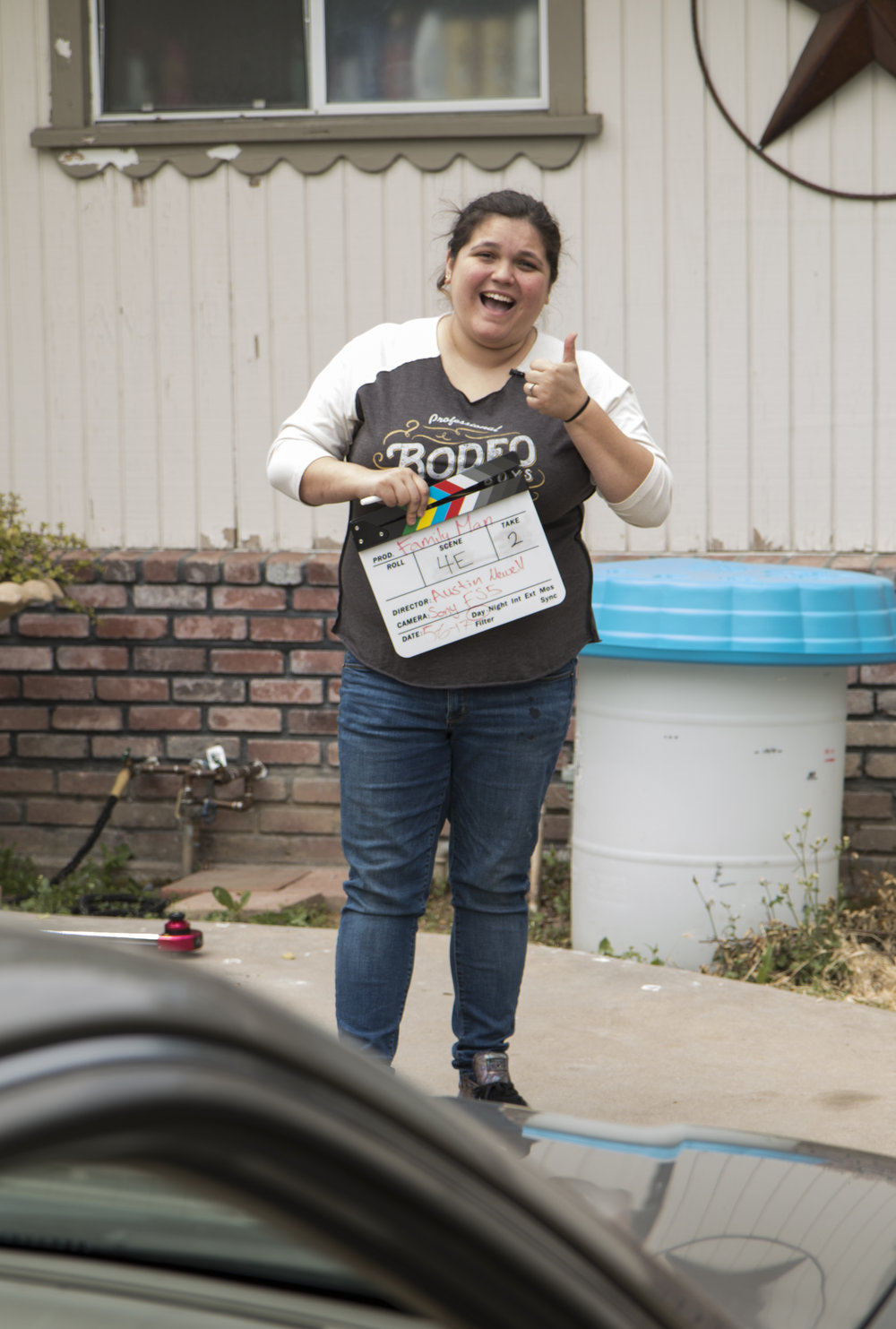 Jess thumbs up with clapboard.JPG