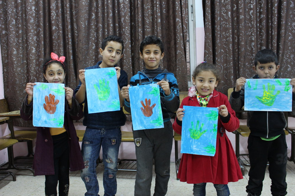 MECI - TSF 30.12.2018 Students in First Beginner class showing their handprint.JPG