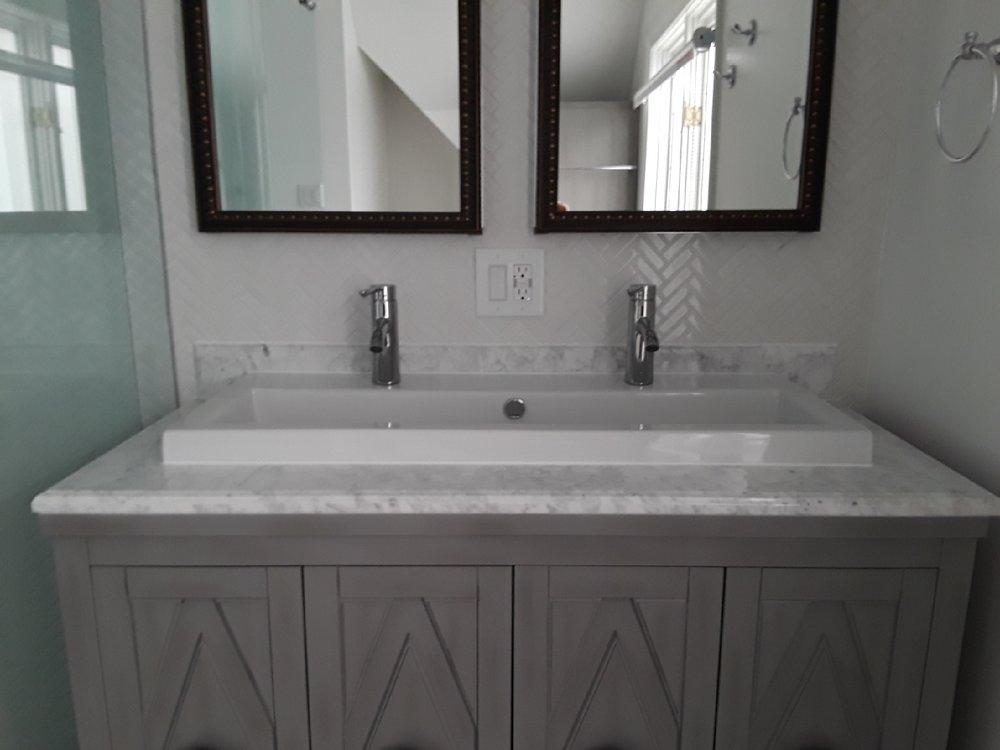 - Herringbone pattern backsplash Trough-style sinkMarble countertop