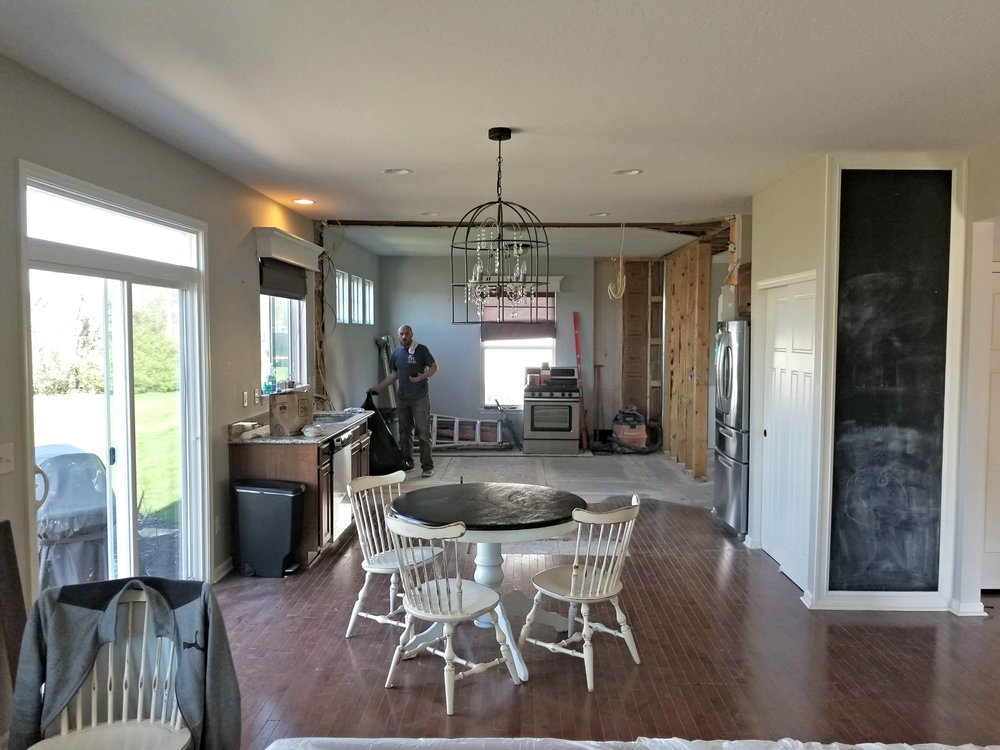 - so the TFL team took down a load-bearing wall. The weight was then distributed to a load-bearing beam that was recessed into the ceiling. All new drywall and paint on the ceiling and new hardwood floors make the space one large, but cohesive unit.