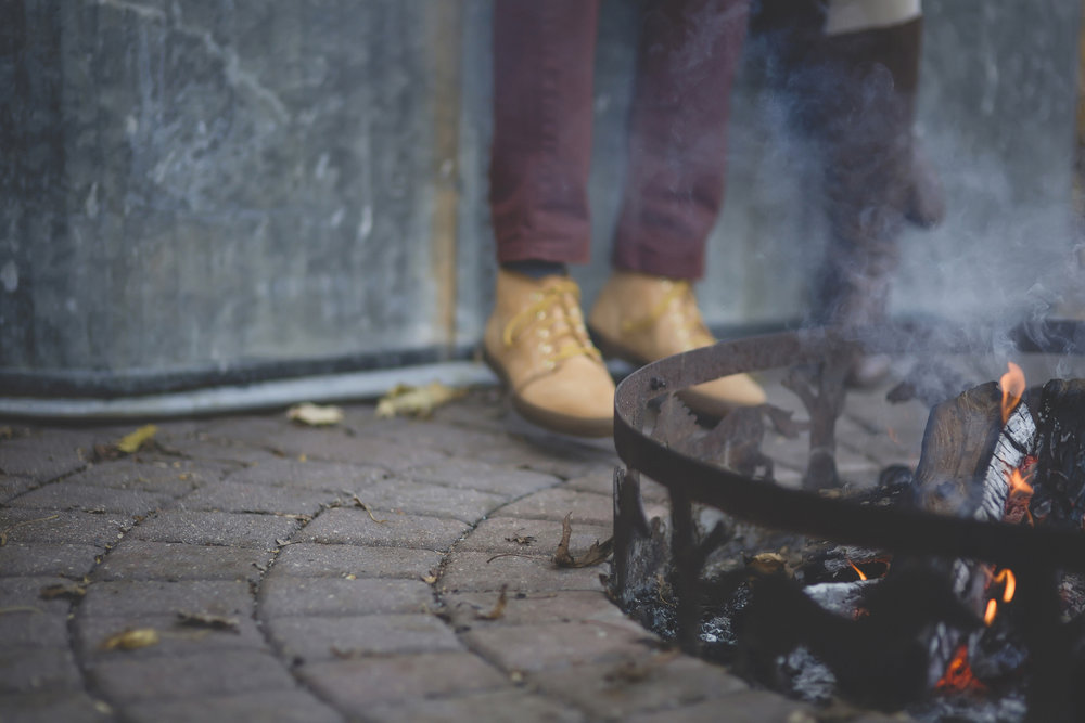 Minneapolis home backyard campfire engagement session 9.jpg