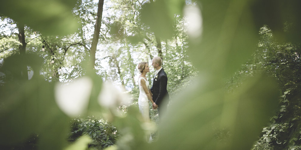31 Minneapolis home backyard wedding couple in forest.jpg