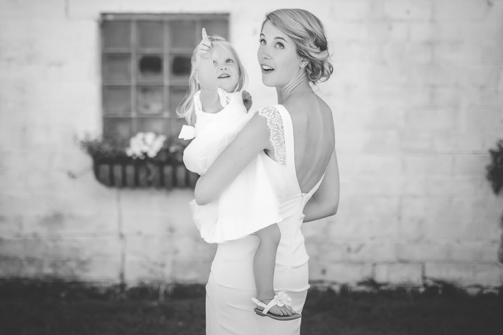 39 Minneapolis home backyard wedding bride and flower girl.jpg