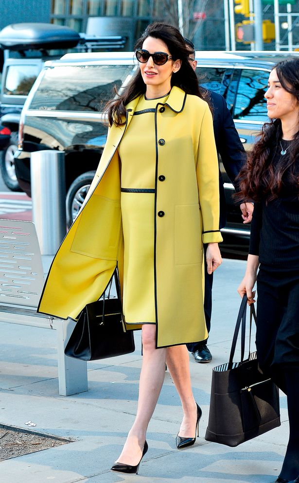 Amal-Clooney-looks-stunning-in-a-yellow-Bottega-Veneta-coat-and-dress-as-she-heads-to-the-United-Nat.jpg