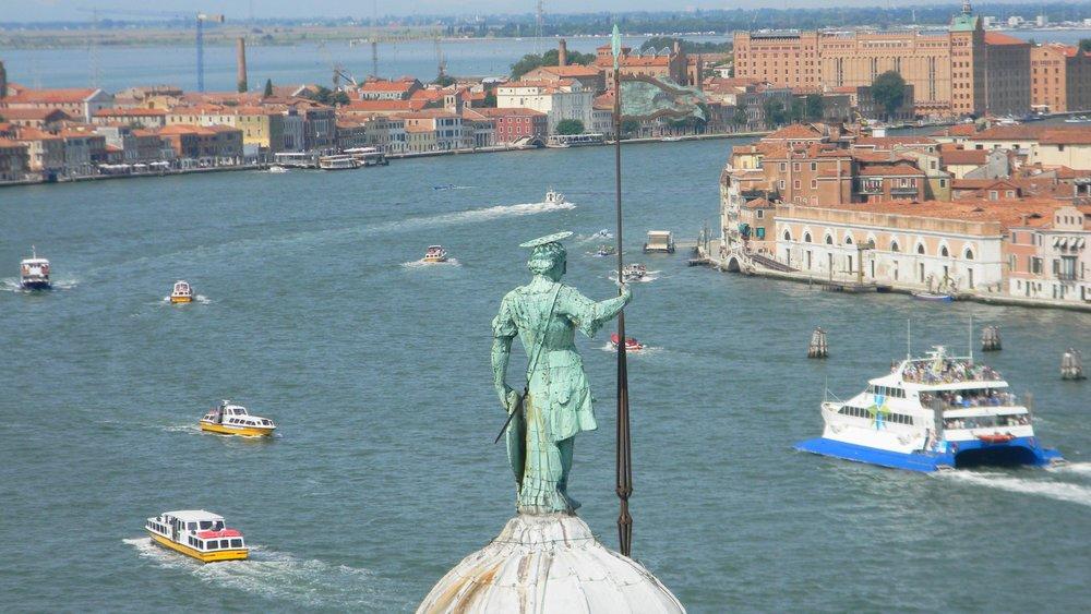 A Renaissance guardian watches over Venice's modern fleet. Photo by me.