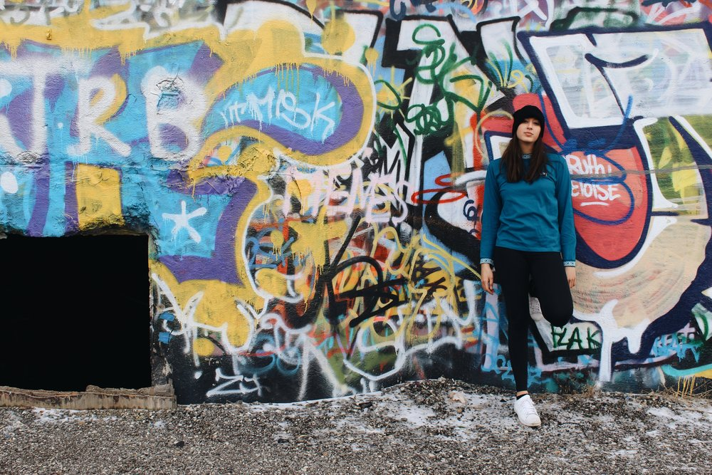 Amanda wears beanie, Urban Outfitters; blue long sleeve, Stussy; leggings and shoes styled as before.