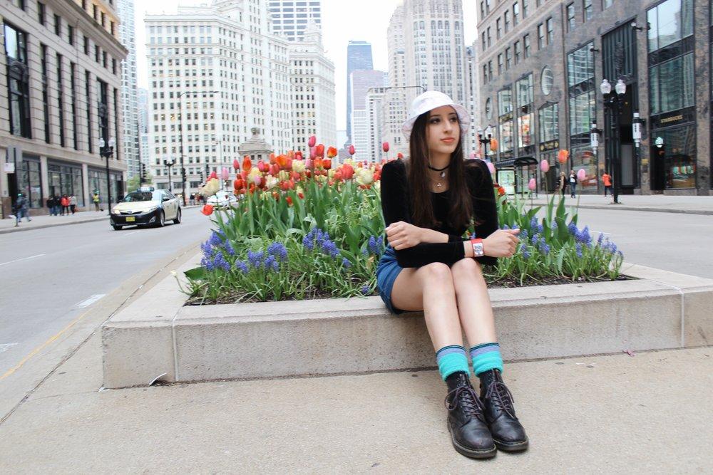 Amanda wears skirt,  G  ap ; vintage ski socks, model's own; boots,  Dr. Martens .