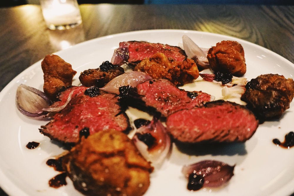 Hanger Steak with SUnchoke, Red Onion, and Black Currant.