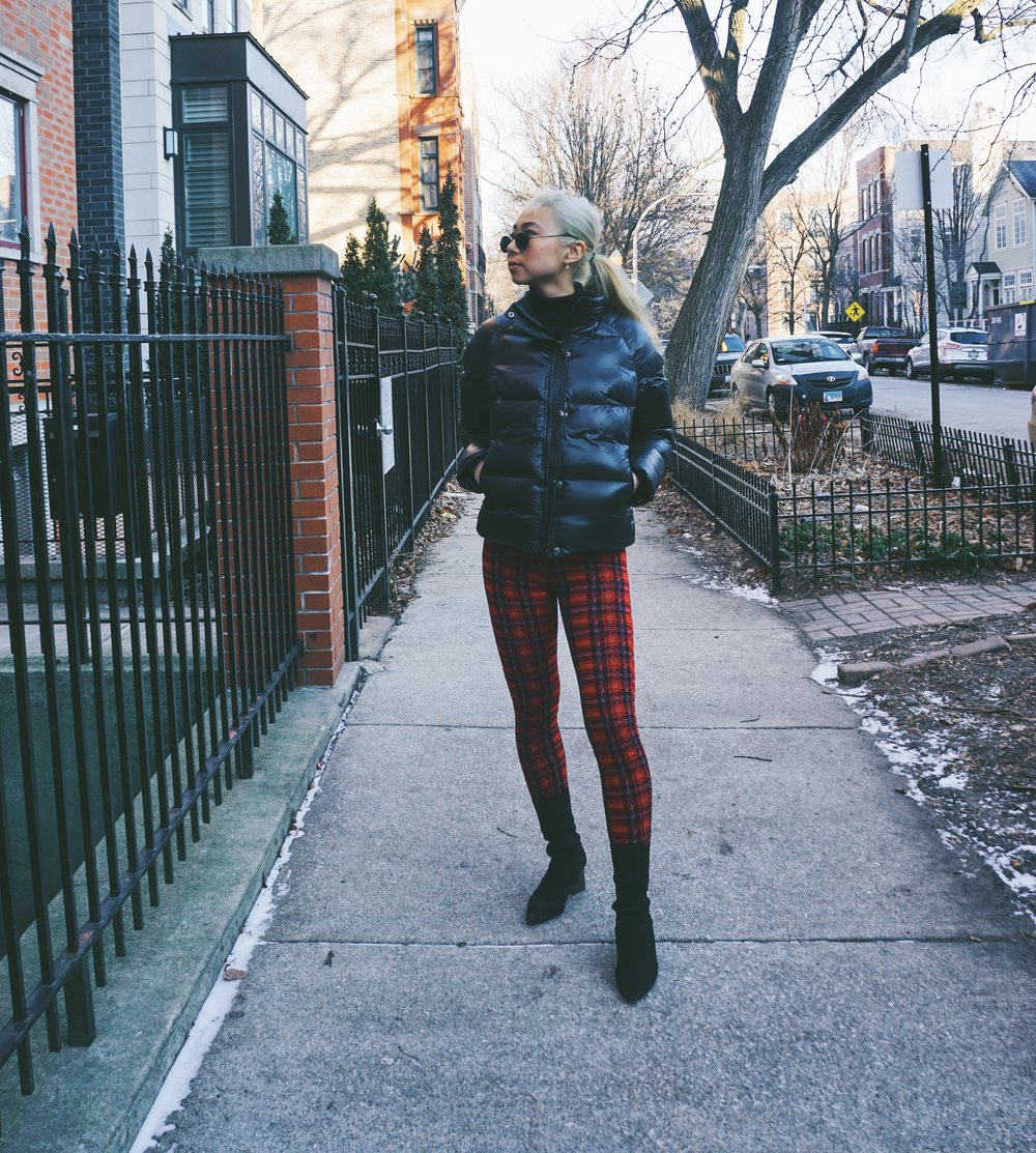 Ginger wears Undercover Jacket,  Snowman New York ; turtleneck,  Theory ; Can't Fail Plaid Leggings,  Akira ; booties,  Zara .