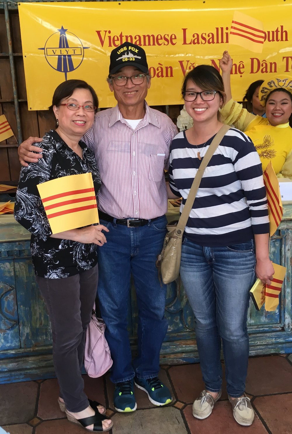 Catherine with her parents celebrating the history of South Viet Nam