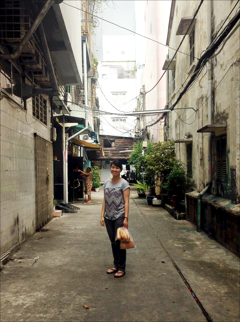 Catherine in the alley by her grandmother's house in Viet Nam