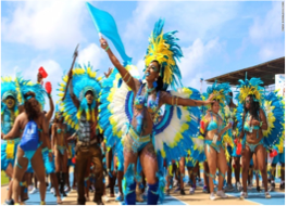 """CROP OVER   Lasting for approximately 5 weeks, and commencing in July, Crop Over is a Barbadian festival celebrating the end of the local sugar cane crop harvest. A summer street carnival, filled with people consumed with """"festival fever"""", dancing to Caribbean soca music and wearing spectacular, multi-coloured costumes and body paint; Kadooment Day is the climax of the Crop Over festival."""