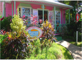 """HOLETOWN CHATTEL VILLAGE    Located within Holetown, on the island's western coast, this shopping centre takes its name from the traditional Barbadian wooden homes, """"Chattel Houses"""", its little shops aim to recreate. Here you can shop for local crafts, art, fashion, souvenirs and gifts, as well as home accessories."""