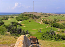 TIERRA DEL SOL GOLF COURSE   Located in Noord, this course offers sweeping views of the coastline, alongside beautiful contrasts of rolling greens landscaped with cactus hazards and water features, providing a game made challenging by the constant tradewind conditions.