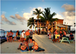 CAYE CAULKER   At night, the island takes a whole new atmosphere where the laziness of the day is replaced by a vibrant party vibe, with tourists filling the many bars, restaurants and beach parties. Cocktails and karaoke bars, live music, outdoor cinema, or a quiet meal, Caye Caulker has it all!