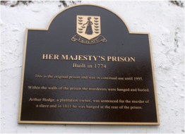 HER MAJESTY'S PRISON      This prison is Road Town's oldest building and has been the scene to historic events such as the execution of Arthur W. Hodge, a plantation owner, on 8th May 1811, for having murdered of a slave.