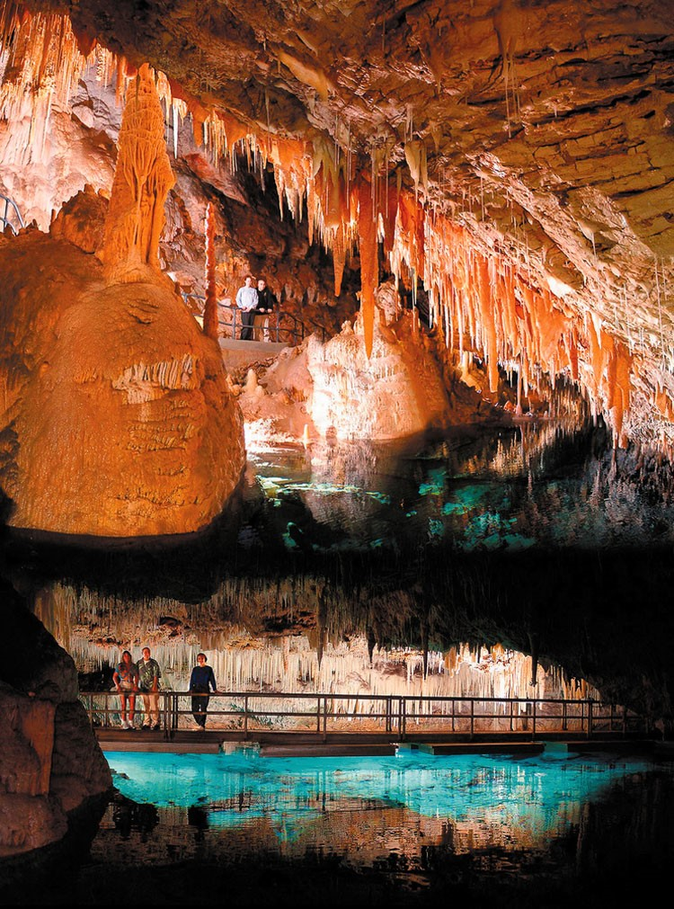 CRYSTAL & FANTASY CAVES   A trip to the northern side of the island would not be complete without a visit to Bermuda's famous Crystal Caves, a stunning and impressive display of underground stalactite, soda straws, chandelier clusters and limestone formations set over a subterranean lake of crystal clear water.