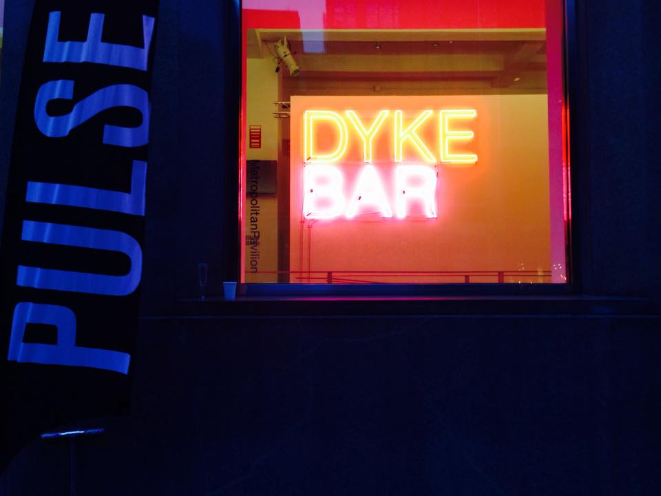 Large DYKE BAR sign greeting PUSLE attendees as they enter the fair