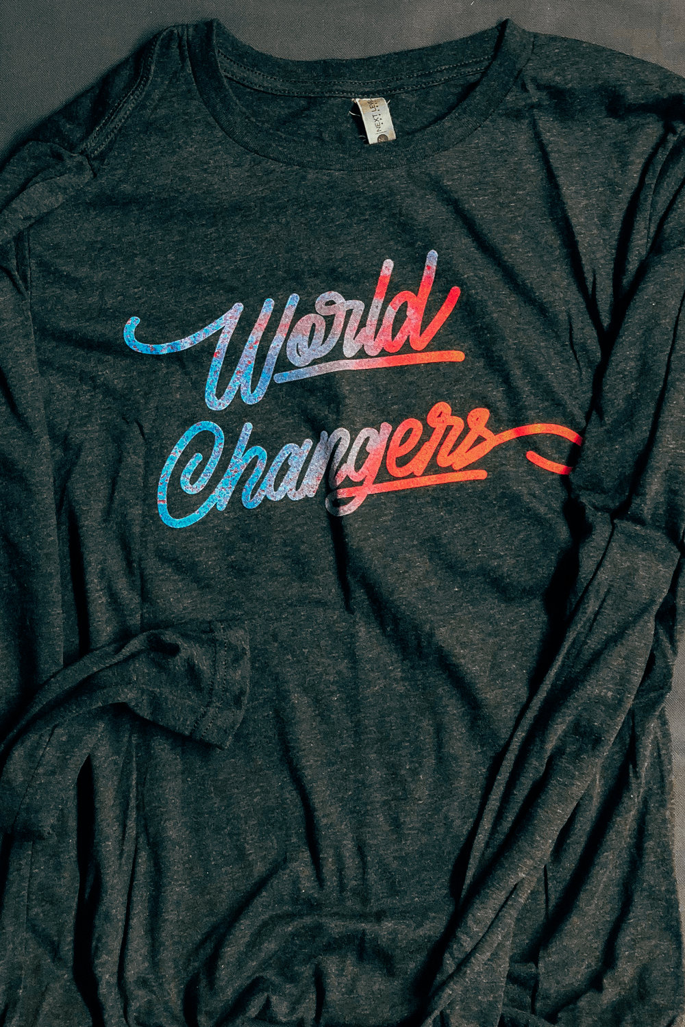 TX YOUTH -  WORLD CHANGERS LONG    $17.00