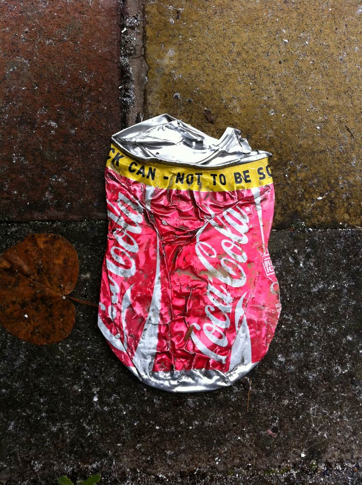 Even-A-Crushed-Can-Of-Coke-By-The-Roadside.jpg