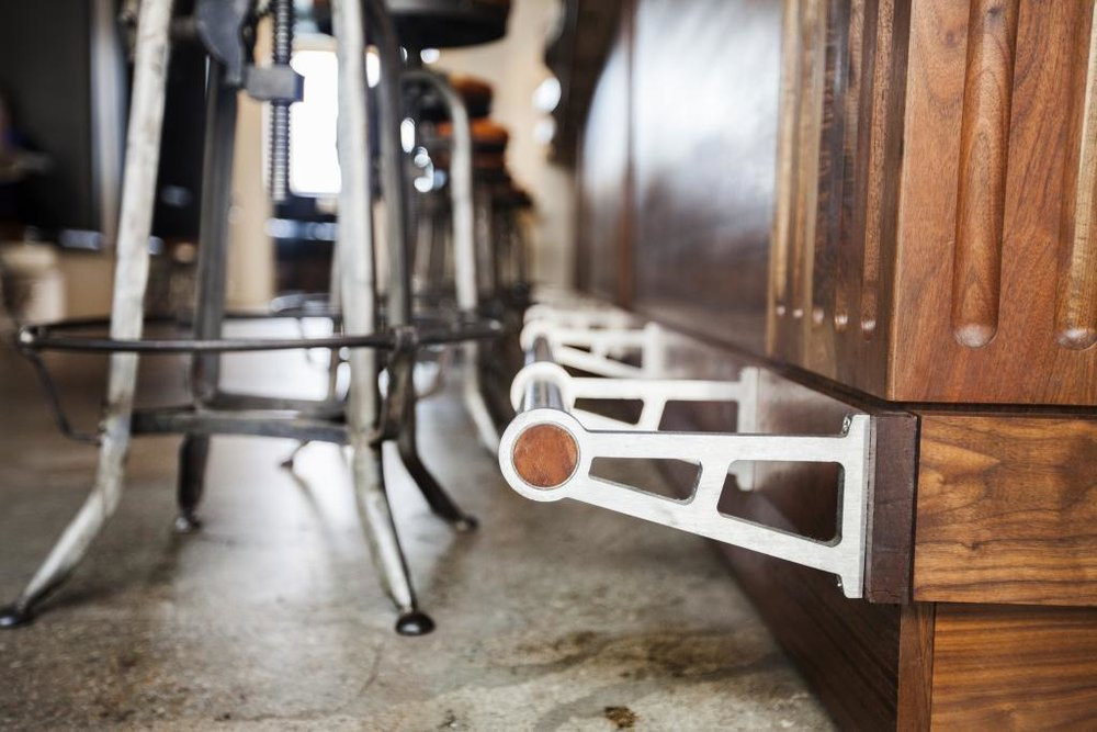 Specially sourced, locally-harvested California walnut hardwood and custom foot rail add to the beauty of this bar.