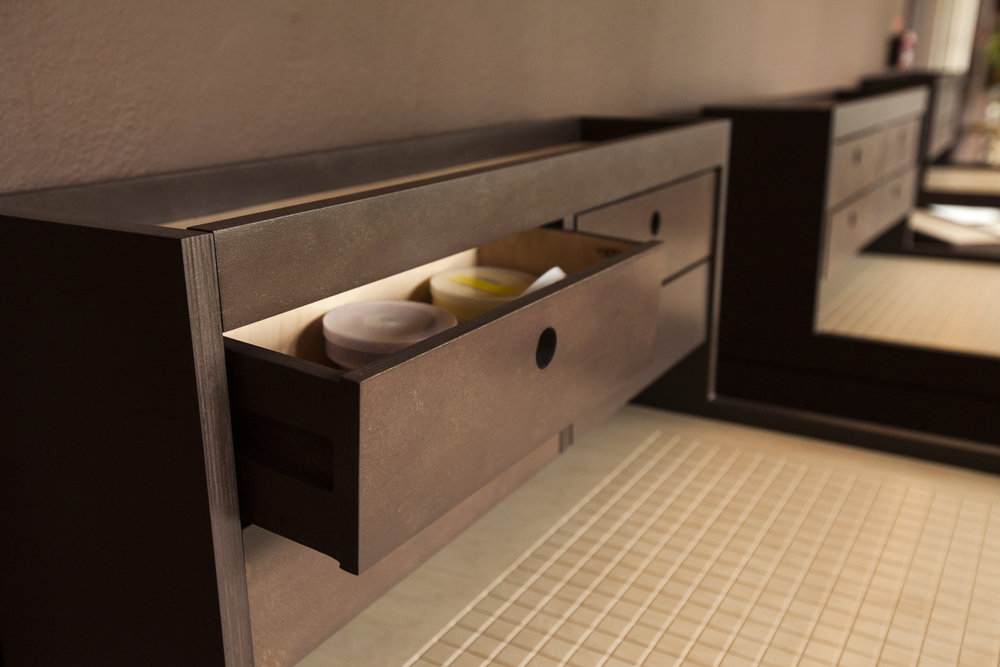 Simple all wood glide drawers reference the architectural time period of the building.