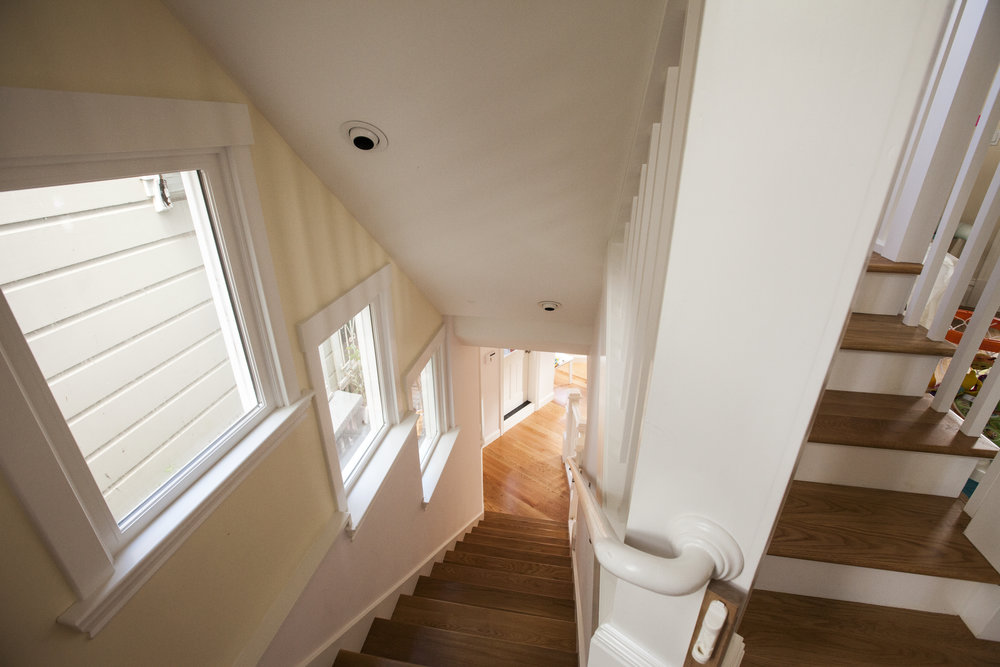 Lots of light was added with windows along the stairway and overhead recessed lighting in the ceiling.