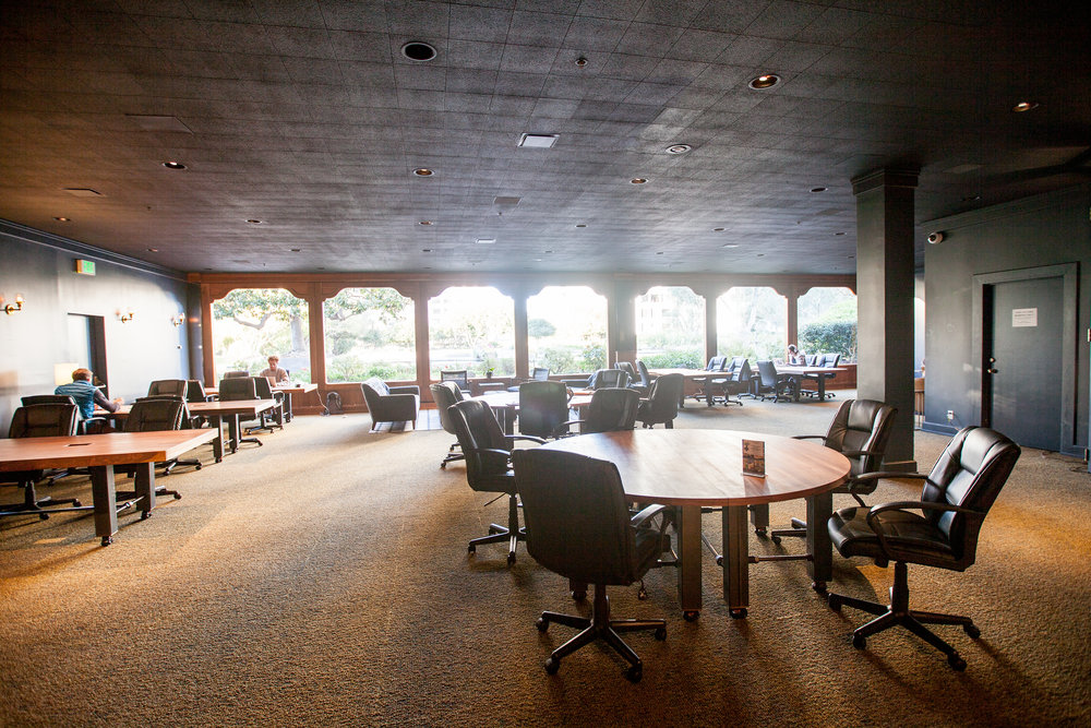 The third floor of the Co-Working space looks out onto a tree filled roof garden. Bright windows light the sea of large worktables created for this room.