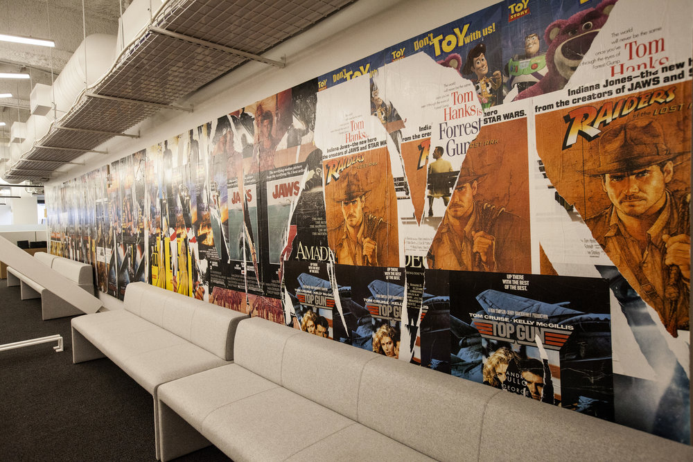 On another floor, a Dolby movie poster paste up wall. We mimicked an urban poster paste up look, using only movie posters from films that used Dolby sound.