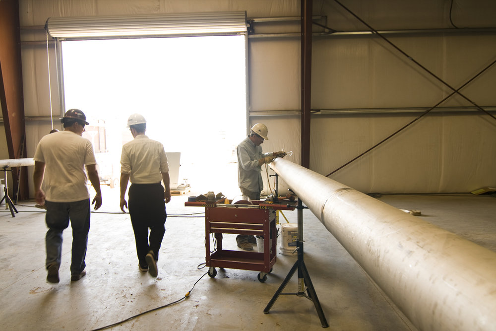 Large doors bring lots of sun into the space. In this back part of the warehouse, workers fabricate specialty pipes.