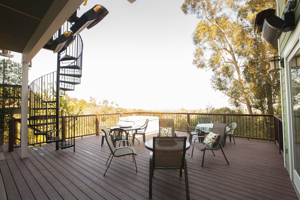 The new deck is twice the size for larger entertaining, taking advantage of the large property.