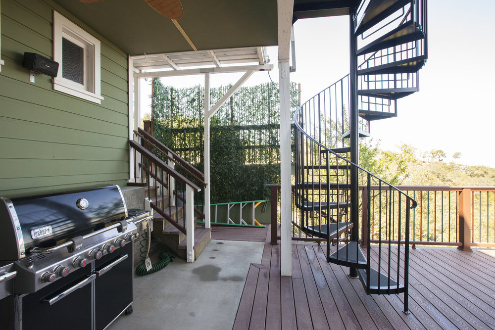 A new spiral staircase connects the upstairs to the outside deck, and the new outside kitchen makes this deck a wonderfully usable space.