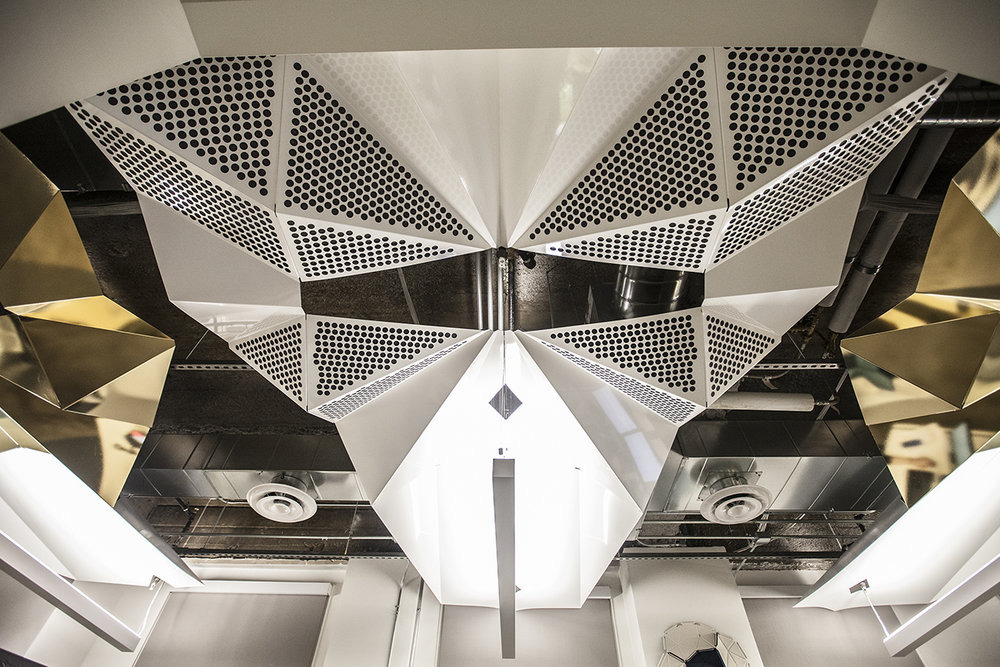 Stunning symmetrical ceiling art for a growing Oakland start-up.