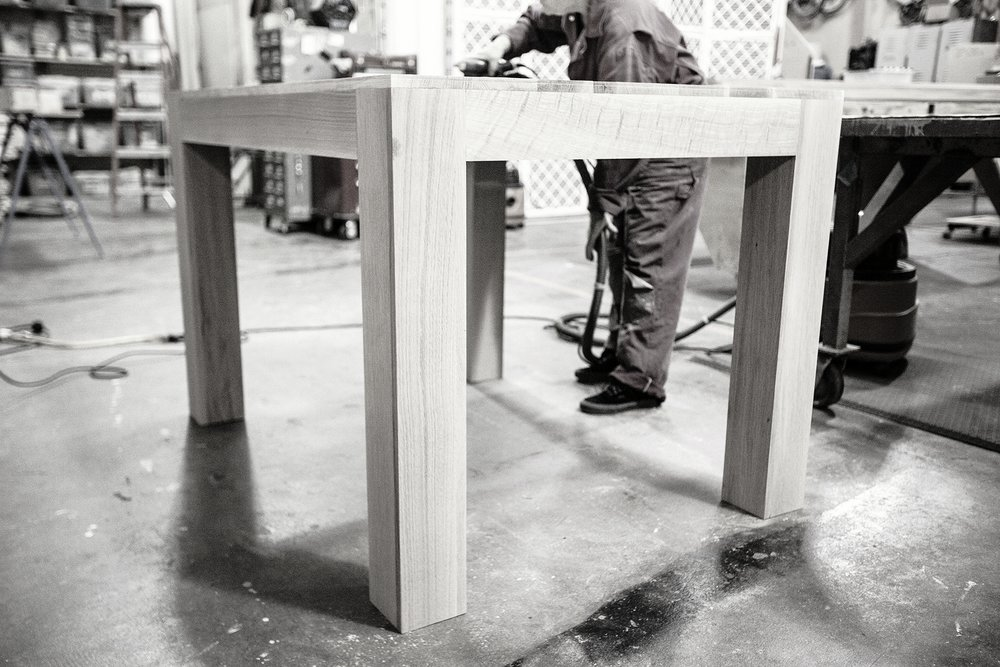 The smaller table design out of oak for the Autodesk Gallery in Ontario, Canada. In our fabrication shop it gets a finish sanding before the final seal is applied.