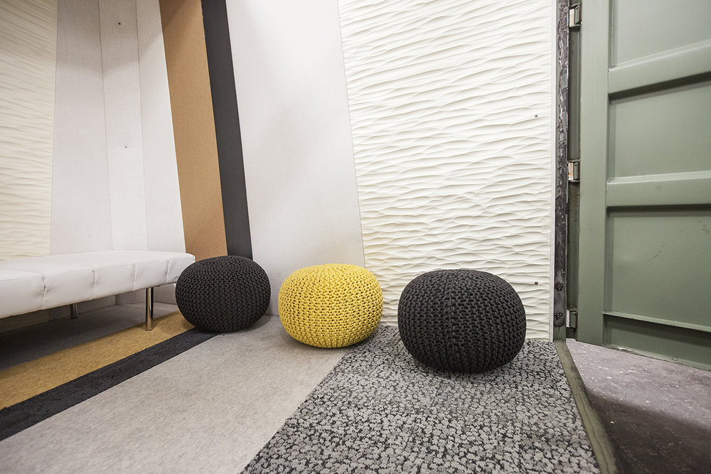 Fun textures line up, making striped patterns around the container lounge interior.