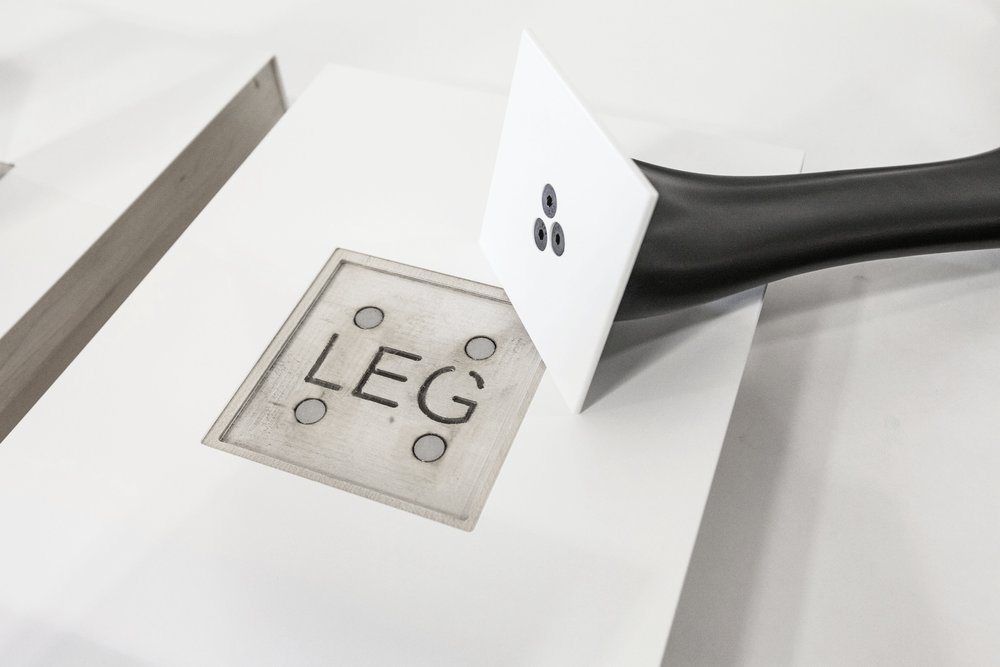 A strong magnetic catch is fabruicated to hold this 3D printed leg sample in an upright position without visable fasteners.